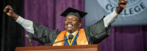 exuberant African American male at graduation podium